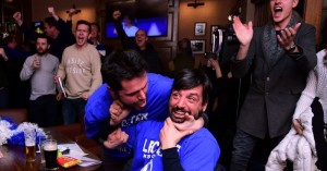Leicester City fans react after Chelsea scored to pull one goal back during the English Premier League football match between Chelsea and Tottenham Hotspur in a pub in central Leicester, eastern England, on May 2, 2016.  Leicester City's remarkable football season could see them crowned champions of England for the first time in their 132-year history without kicking a ball on May 2 if second-placed Tottenham Hotspur fail to keep the Premier League title race alive. Anything less than a Spurs victory away to London rivals Chelsea at Stamford Bridge (1900GMT) -- a ground where they haven't enjoyed a league win for 26 years -- will see Claudio Ranieri's men, 5,000/1 outsiders in pre-season, complete a stunning triumph.  / AFP / LEON NEAL        (Photo credit should read LEON NEAL/AFP/Getty Images)